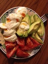 Quick and easy power breakfast: Boiled eggs, Tomato, and Avocado sprinkled with a little pepper and Himalayan salt!