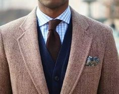 Nice clean look, with light grey blazer with navy waistcoat. Like the shirt, not sure about the tie, don't like the pocket square