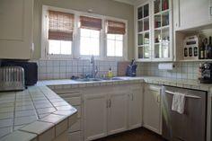 Nick's Beachwood Canyon Modern Mix. Practical white kitchen, lots of white square tile.