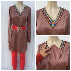 Tunic top Beautiful tunic top in taupe with embroidery on neckline . Looks great with pair of leggings and detailed belt for looks as pictured . Belt not for sale . Leggings available in other listing for sale . Tops Tunics