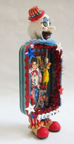 Wicked Child Altered Tin: Captain Spaulding as a boy. Made for a swap on Craftster. (K.Batsel)