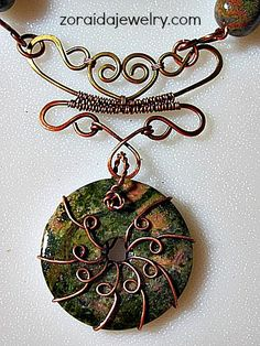 Unakite Donut Wire Wrapped Necklace. This design, as a whole, contains lots of ideas.  You wouldn't have to take on the entire project...just glean inspiration from certain parts.