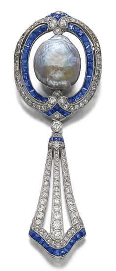 A Belle Epoque sapphire, diamond and cultured pearl brooch, circa 1910, with later modification. In April 1972, the cushion-shaped diamond weighing 17.13 carats was removed from the centre of the brooch and replaced with the cultured pearl, to make it a more suitable jewel for every-day wear. #BelleÉpoque #brooch