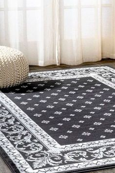 This elegant rug's medallions and acanthus leaf border are inspired by traditional French rug patterns. Our version in deep charcoal and ivory is the perfect way to update a living room, bedroom, entry, office or dining room. This versatile and elegant rug works beautifully in both traditional and modern spaces. Leaf Border, Rug Patterns, Interior Decorating, Interior Design, Acanthus, Modern Spaces, Home Rugs, White Area Rug, Home Decor Trends