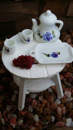 Adorable little tea set, it comes with the tray, 2 teacups and a teapot adorned with a cute little shabby chic purple flower design, along with some fresh-picked grapes. The fairies are going to love this, sweet dollhouse accessory. Perfect gift for a little girls Tea Party for her fairies. Size is 1:12 scale