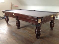 9ft Jelks antique snooker table restored, and re-covered in silver cloth.