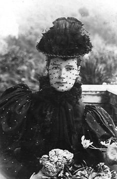 1894 or 1895. Maria Feodorovna (1847-1928) wears a scarf-ruff that completely seals off her neck and a dress with big leg-o-mutton sleeves in this photo. Her husband, Alexander III, died in 1894 so she is in mourning.