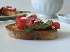 Bruschetta - An Italian appetizer made of fresh toasted bread topped with fresh tomatoes, basil and Parmesan cheese.