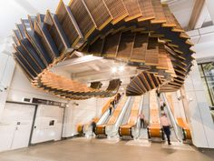 """""""Interloop"""" by Chris Fox. 244 wooden steps from an old escalator turned into a work of art in a Sydney underground station."""