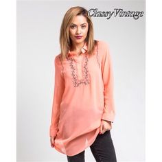 Coral silk blend chiffon top. NWT Long sleeves with embroidered button front. This stunning top is 85. % rayon and 15% silk. NWT and comes in size S,M and L. This is size large. Boutique Tops