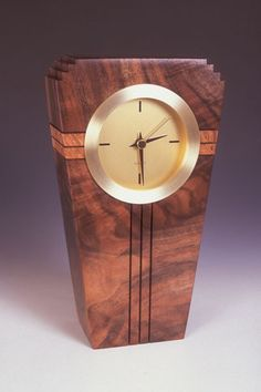 Howard Griffiths - Walnut & Maple Burl - Metro Clock This striking clock is made from Walnut with a strip of Maple Burl running through the center and measures 10x5.5x2. This beautiful piece looks gre
