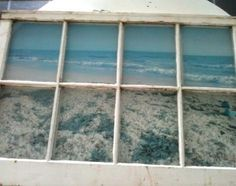 Create a faux ocean view with an old window by enlarging a photo and mounting it behind the frame.