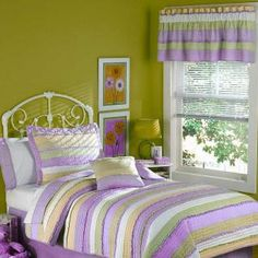 Purple, green, white, and orangeish quilt