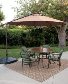 Cantilever umbrellas are basically offset patio umbrella. Generally, cantilever umbrella may have co Offset Patio Umbrella, Cantilever Umbrella, Outdoor Rugs, Outdoor Living, Outdoor Decor, Outdoor Spaces, Ladies Umbrella, Backyard Patio, Backyard Ideas
