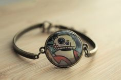 Handcrafted BB8 bracelet.  Made by hand from a Star Wars comic book. I use all the pages from the book that I can and recycle the rest.