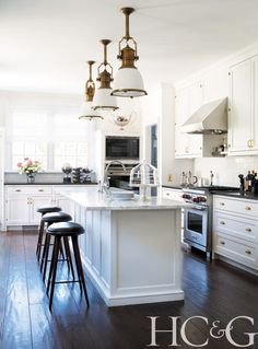All-white Kitchen with pendant lighting