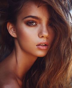 Bronzed skin, more hair and golds and coppers with warm highlighting