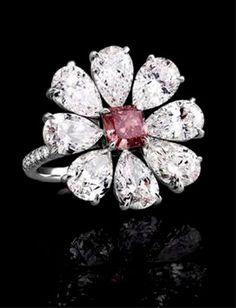 Flower bling ring—white and pink diamonds.