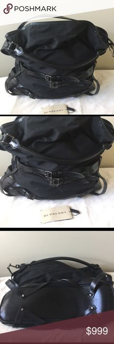 Burberry Bridle Gosford Large black Hobo Tote Burberry All black leather and canvas LARGE Gosford hobo tote. Two shoulder straps/ handles make this a great travel bag. Three sections inside for separation, middle section zips plus side zip pocket. Small ink stain on lining See photo. Only carried a few times. No damage on bottom except 1 tiny scratch. Size is 20x18x5. Burberry Bags Totes
