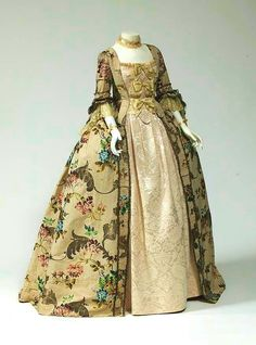 Mid 18th century robe a la francaise of silk brocaded with polychrome silk floral pattern and silver wrapped thread.