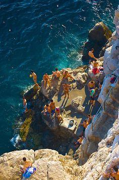 Jump off cliffs at Cafe Bruza in Croatia