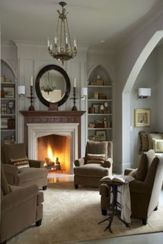 I love this arrangement of chairs around the fireplace. To conserve space, I could mount my TV over the fireplace and just have 2 chairs w/a table in between, facing the fireplace and TV. Like the built-in bookshelves on the sides too. My Living Room, Home And Living, Living Spaces, Cozy Living, Small Living, Style At Home, Beautiful Interiors, Beautiful Homes, House Beautiful