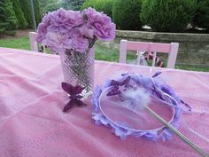 I found cute glasses from Home Goods that I used as vases for put purple flowers on the kids table!