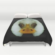 Duck or eagle? Duvet Cover It looks a bit like the face of a duck, but actually it's a mirrored bald eagle. You will see it, when you turn your head to the left or right. It's based on this pic:  https://society6.com/product/mm-bald-eagle-portrait_print#1=45  animal, bald eagle, beak, bill, bird, black, duck, eyes, face, fun, funny, humor, humour, nib, optical illusion, photography, visual trick, white