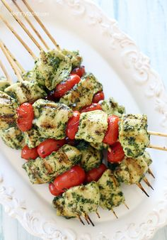 Grilled Pesto Chicken and Tomato Kebabs- I feel like this needs a little mozarella, then they would be perfect!