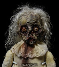 https://flic.kr/p/8FCLyf | Mattie – Zombie Art Doll | Mattie – Zombie Art Doll  Made this to Donate to the October 2010 Chiller Charity Auction.  Handmade Doll Sculpture. 8.5 inches tall. Mixed media.  Copyright © 2010, Shain Erin. All rights reserved.