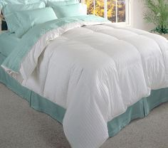 This 600-thread-count white down comforter is filled with authentic Siberian down that keeps you warm even on the coldest of winter nights. It features baffle-box construction that keeps the down in its place, so you will stay warm all night long.