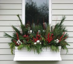 outdoor lighted christmas decorations Landscape Traditional with christmas decor Christmas window box pine needles red and green silver decorations Winter Window Boxes, Christmas Window Boxes, Christmas Planters, Christmas Window Decorations, Christmas Porch, Vintage Christmas, Box Decorations, Silver Decorations, Fall Planters