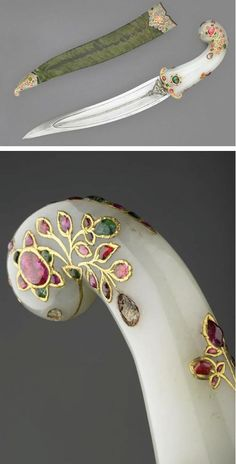 Mughal Dagger Dated: 17th century - 18th century Culture: North India Medium: Jade, steel, gold and cabachon rubies and emeralds Measuremenrs: Length: 24.1 cm, blade Unknown Artist / Maker Source & Copyright: The Wallace Collection