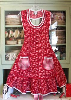 Aunt Rosie Full Ruffle Women Apron - #2100 - $59.95 ex-large $5.00 - Retro red polka dot woman apron in Aunt Rosie style. A full retro red polka dot woman apron with red gingham pockets and a beautiful ruffle for a feminine apron. White trim around this beautiful woman apron with round pockets. stitchthrutime.com Stitch Thru Time - Most adorable aprons! Great for gifts - Handmade in America