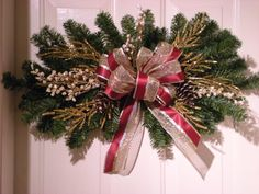 Decorative Holiday Pine Swag with Natural pinecones,Christmas Swag,. $14.95, via Etsy.