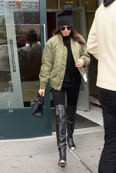 Kendall Jenner wearing Hermès Birkin 25cm Bag, Saint Laurent Classic 11 Aviator Sunglasses, Adidas Yeezy Season 1 Quilted nylon bomber jacket, Chanel Calfskin Leather Boots with Metal Cap Toe