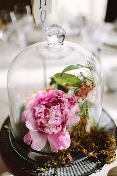 bell jar centerpiece, photo by Pat Furey http://ruffledblog.com/roundhouse-beacon-wedding #weddingideas #centerpieces