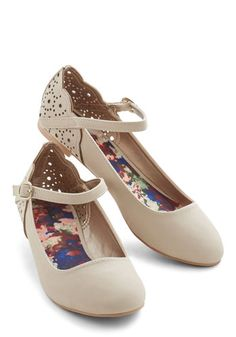 Enjoy every moment you spend in these ready-to-style beige ballet flats. Composed of smooth vegan faux leather with gold-buckled ankle straps, this versatile pair, with their round toes, scalloped edges, and dot-perforated backs, deserves to be cherished.
