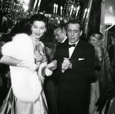 """Ava Gardner and Humphrey Bogart at the premiere of """"The Barefoot Contessa"""", 1954."""