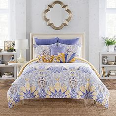 Turn your bedroom into a fashion runway with the Anthology Lyla Comforter Set. This bedding combines trendy and classic themes with repeating scallop pattern in beautiful periwinkle and yellow, and reverses to a yellow and white print.