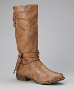 Embrace the chill in major style! Fun, hip and trendy, these riding boots feature a low heel for all-day wear and a decorative string for a touch of charm.1'' heel12'' shaft13'' circumferenceSide zipper closureMan-madeImported