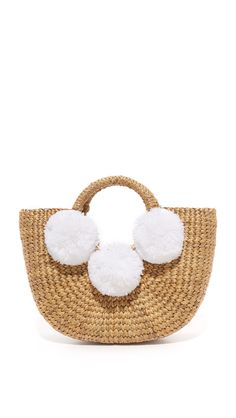 This JADEtribe Basket Mini Pom Pom Bag is a must have spring accessory