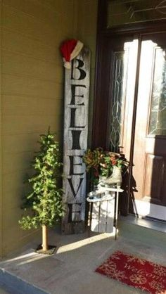 40 Cool DIY Decorating Ideas For Christmas Front Porch by love-it by heather   LOVE THIS BELIEVE SIGN WITH THE SANTA HAT!!!