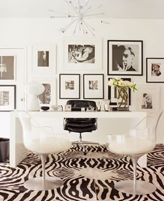 I like the photos display in the back. Martyn Lawrence-Bullard's office... LOVE IT!