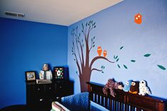 Charlie's owl-themed baby room. (: