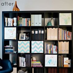 Tanya created hanging canvases to cover certain cubbies. (via designsponge)