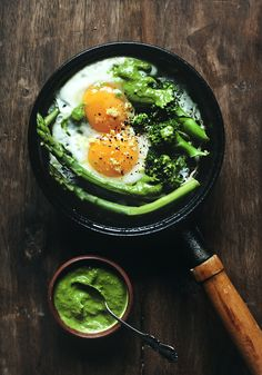 Seasonal Stovetop Eggs: Broccoli & asparagus cooked with eggs, some lemon zest grated on top, & served with green pesto / Lily