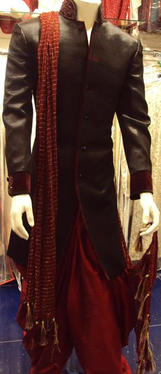 Black brockade with maroon piping. I'd wear the sherwani with churidar bottoms instead of the shalwar Indian Groom Wear, Indian Attire, Indian Wear, Indian Wedding Outfits, Pakistani Outfits, Indian Outfits, Mens Sherwani, Wedding Sherwani, Groom Outfit