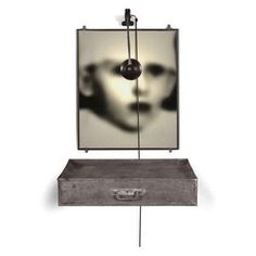 Christian Boltanski,   Tiroire,  Executed in 1988.  black and white photograph, tin drawer with wire mesh lid, clothes and light