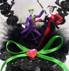 Beautiful 1 of a kind cake Topper Only $41 Wonderful PVC Detailed figures!   Pretty shimmering heart backdrop with sexy black accents.   9 inches tall. Mounted on 4 3/4 inch wide cake base.   __________________________________________________________________________ Matching items can be added for extra COST ( will have Joker with HARLEY ( not pictured) Set of Toasting glasses, Cake Knife and Server set. only $54 ( will be made to match topper) Batman and Wonder women ( not pictured) 2 B...